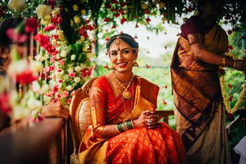 South Indian bride in orange saree
