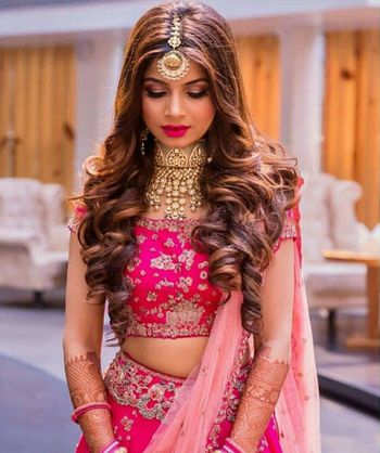 Wavy open hair for engagement or sangeet