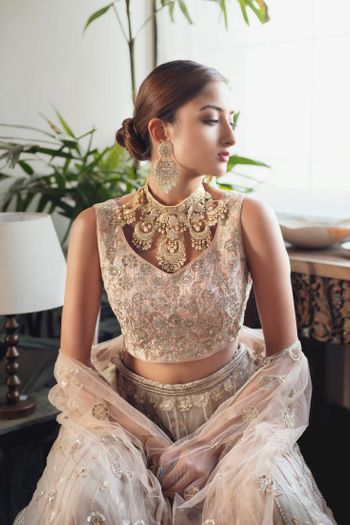 Photo of Unique heavy jewellery with light embroidered lehenga.
