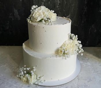A two-tier engagement cake with flowers.
