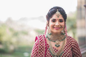A happy bride in traditional lehenga