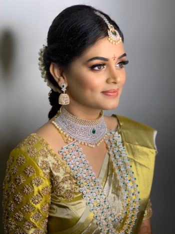 A south indian bride wearing dewy and subtle makeup