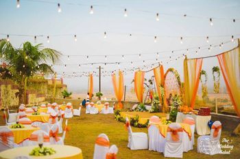 Orange and yellow theme outdoor round table setting
