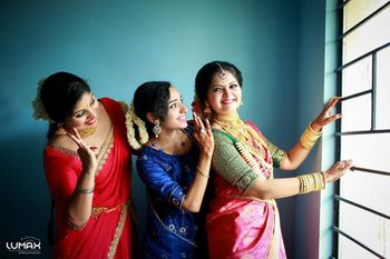 A south Indian bride laughing with her bridesmaids