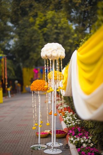 Entrance decor with marigold bunches on stands