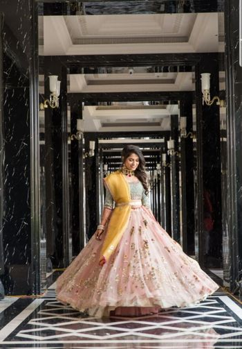 Sangeet lehenga with pink skirt and contrasting dupatta