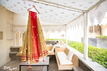 Gold Sequin Lehenga with Red Dupatta on Hanger