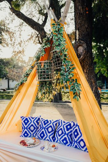 Vibrant teepee tent seating.