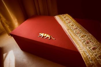 Photo of Sabyasachi bridal box with lehenga