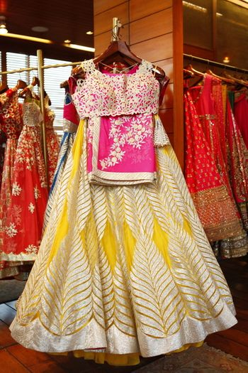 Photo of yellow and pink mehendi lehenga