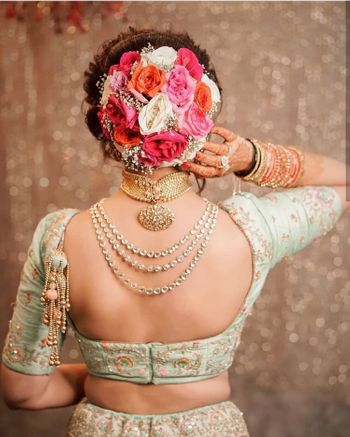 Photo of Big bridal bun with roses
