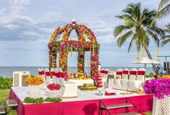A dome-style open mandap made of flowers