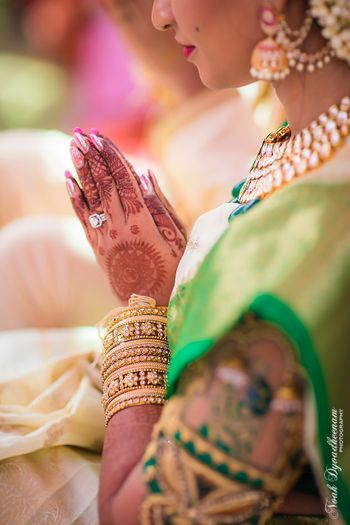 Bridal hands with mehendi and engagement ring