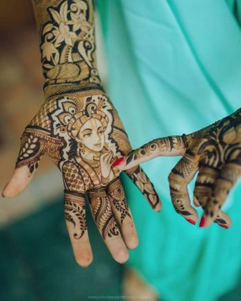 Unique bridal mehendi with Krishna idol