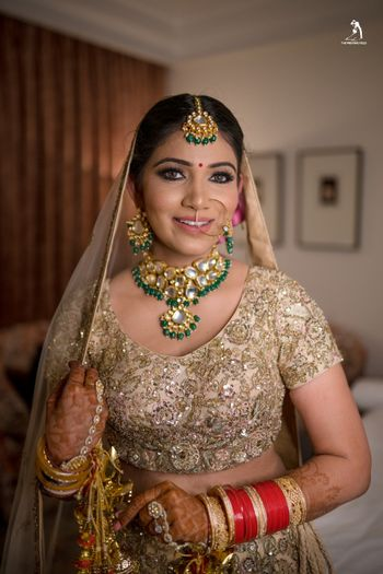 A bride dressed in golden lehenga
