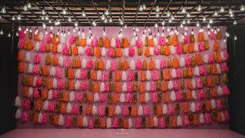 Stage decor photobooth with tassels for mehendi