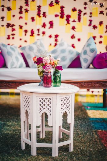 Photo of Mehndi decor idea with a small table and mason jars