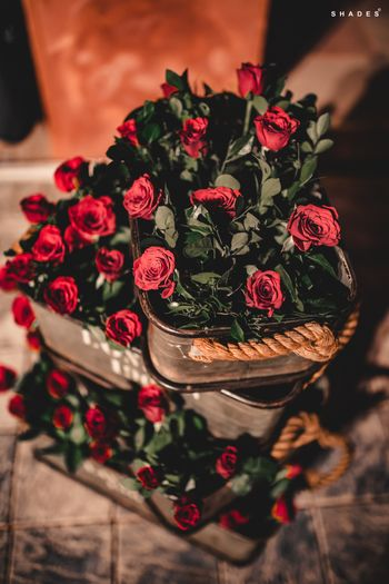 Engagement decor idea with roses in tins
