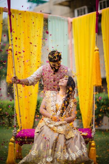 Adorable couple shot under a flower shower