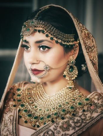 An indian bride wearing polki and jadau jewellery for her wedding