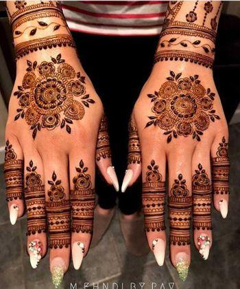 A beautiful minimalist back mehndi design.