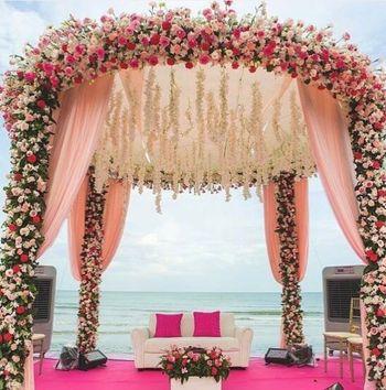 Floral beachside wedding mandap with sofa