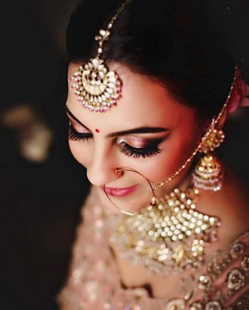 Smokey eyes, subtle bridal makeup