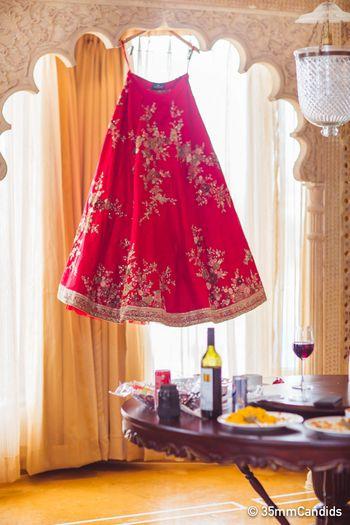 Bridal room photo idea with lehenga on hanger
