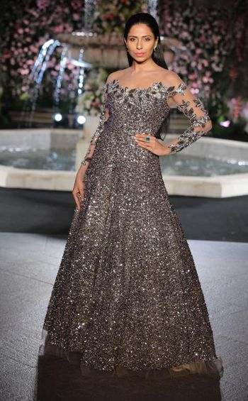 Photo of Dark grey sequin gown with sheer sleeves