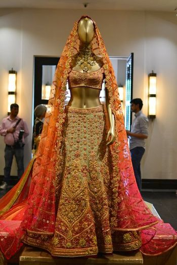 Tarun tahiliani orange pink and grey bridal lehenga