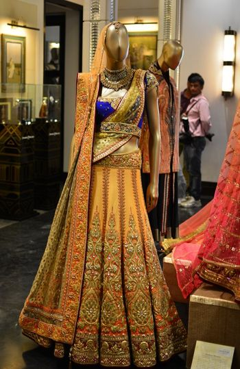 Tarun tahiliani blue and yellow bridal lehenga
