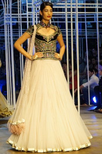 powder pink net flared lehenga with blue velvet corset blouse