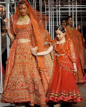 Red and orange heavy bridal lehenga