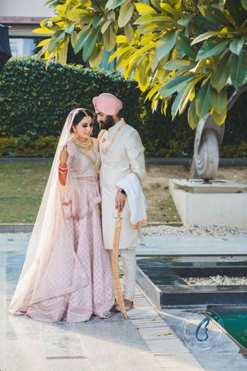 A Sikh wedding with the couple in Pastel outfits