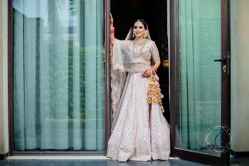 A bride in a Pastel pink bridal lehenga