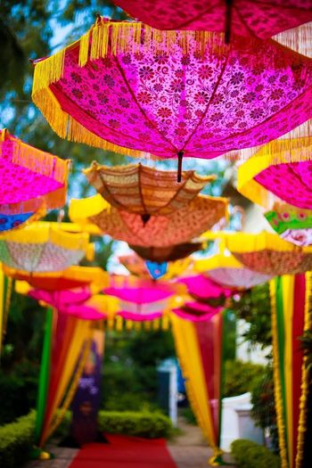 Hanging parasols for entranceway decor for the mehendi