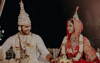 A bright and happy Bengali couple shot.