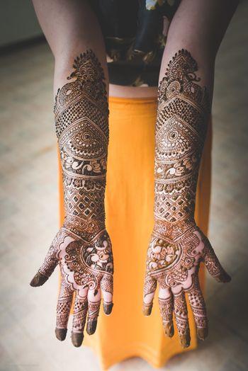 full arm mehendi design on both hands