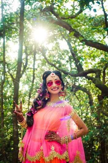 Photo of Bride to be in sunnies on mehendi day