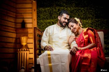 South Indian bride and groom share a candid moment at their engagement.