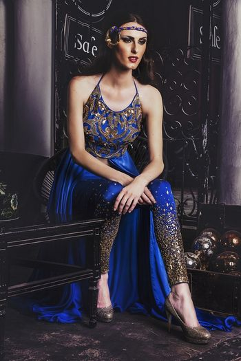 Photo of blue sleeveless halter neck indo western outfit with slit and shimmer pants