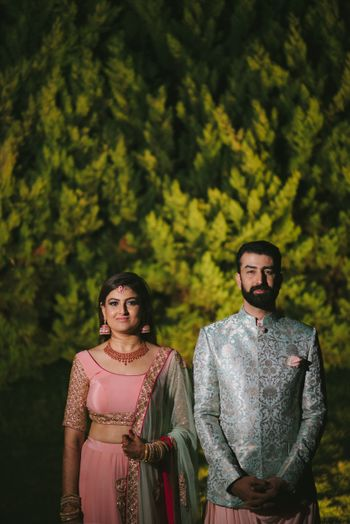 Photo of Pastel bride and groom in matching outfits
