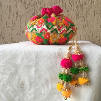 Colourful potli for mehendi with hanging pompoms