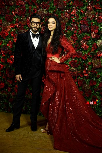 Deepika in a red sequinned gown and Ranveer Singh in a black tux for their reception.