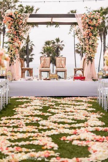 A floral walkway leading upto a floral mandap setup