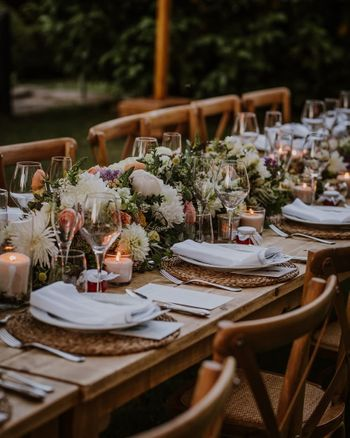 Floral decor with rustic touches for the table settings.