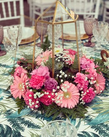 Terrarium centrepieces with floral decorations.
