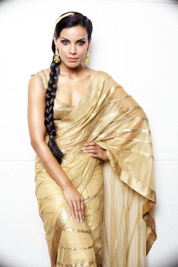 Photo of Gold monotone saree with zari lines and side braid