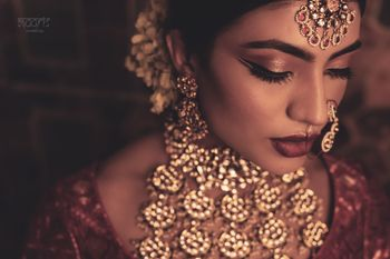 A bride in polki and jadau jewellery for her wedding day
