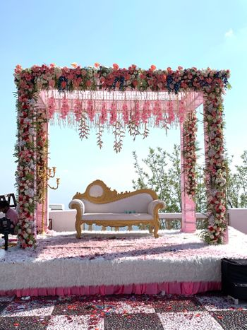 An elegant stage decor setup with suspended flowers